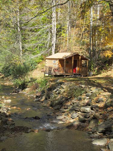Rustic cabin by cool mountain stream